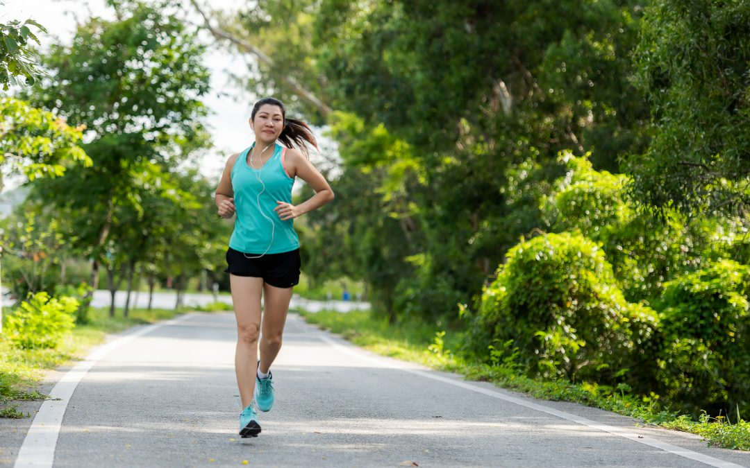 Healthy woman jogging run and workout on road outdoor.